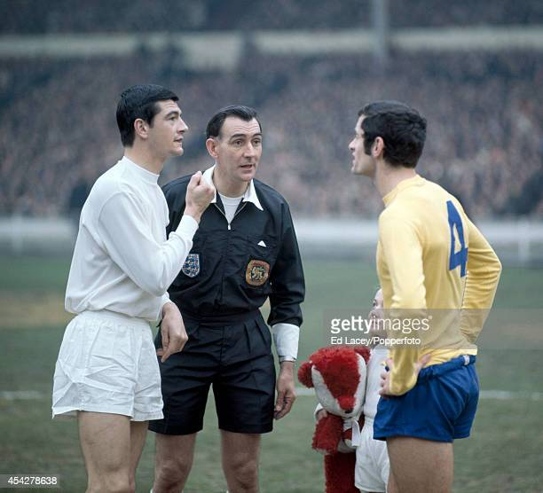 Referee Bill Handley with the team captains Stan Harland of Swindon Town and Frank McLintock of Arsenal prior to the League Cup Final at Wembley...