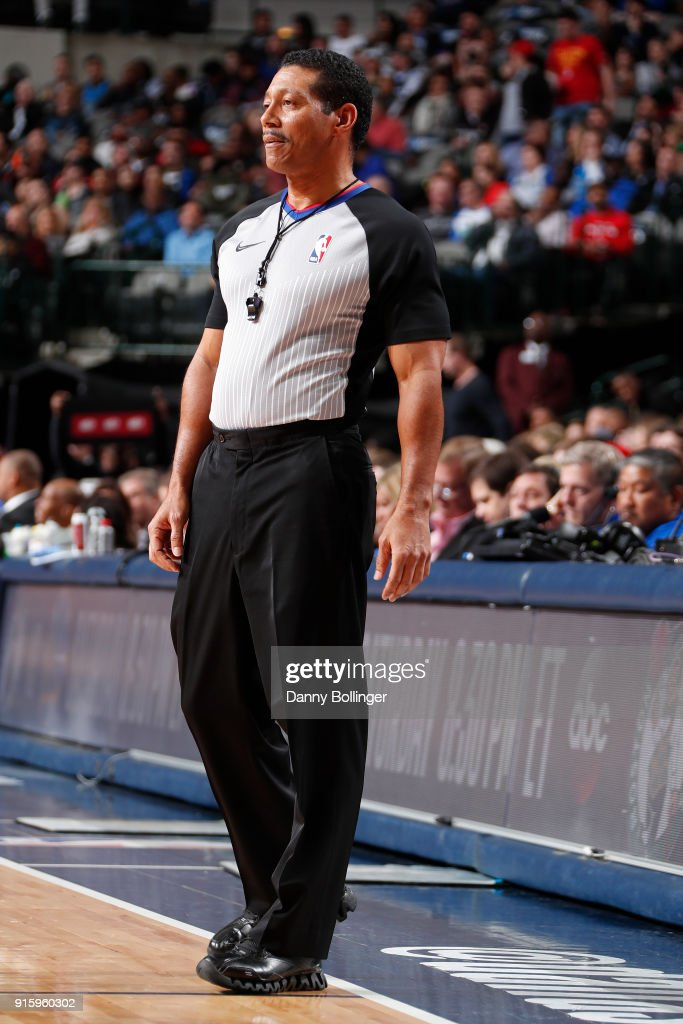 Referee Bill Kennedy looks on during the game between the Houston Rockets and the Dallas Mavericks on January 24, 2018 at the American Airlines Center in Dallas, Texas.