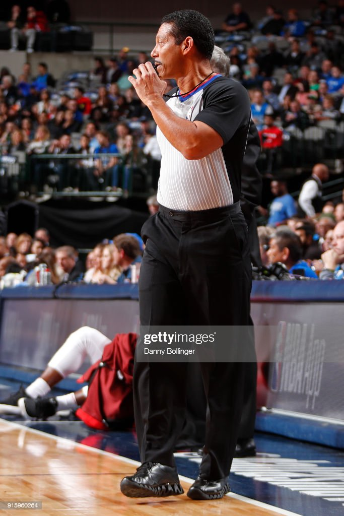 Referee Bill Kennedy makes a call during the game between the Houston Rockets and the Dallas Mavericks on January 24, 2018 at the American Airlines Center in Dallas, Texas.