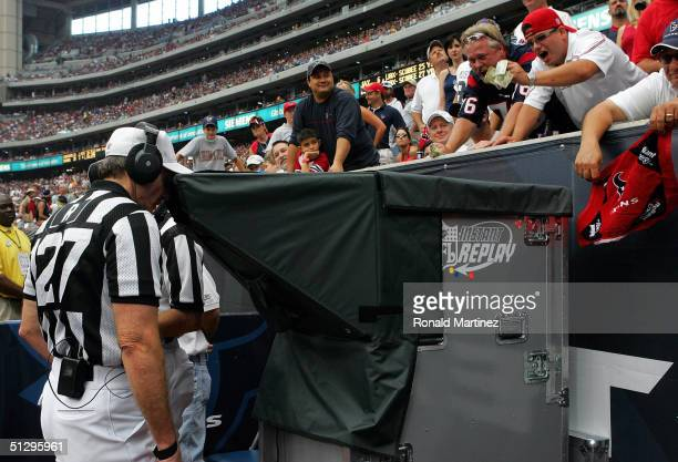 Referee Bill Leavy reviews a San Diego Chargers touchdown on instant replay during a break in action against the Houston Texans on September 12 2004...