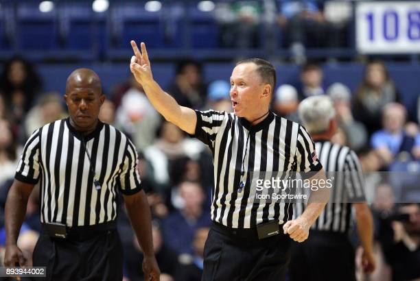 Referee Bill McCarthy signals two free throw attempts during a college basketball game between Charleston Cougars and Rhode Island Rams on December...