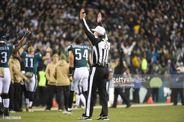 Referee Bill Vinovich signals a touchdown during the game between the New England Patriots and the Philadelphia Eagles on November 17, 2019 at...