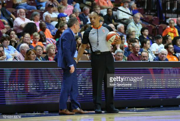 Referee Billy Smith speaks with Connecticut Sun head coach Curt Miller during a WNBA game between New York Liberty and Connecticut Sun on August 1 at...