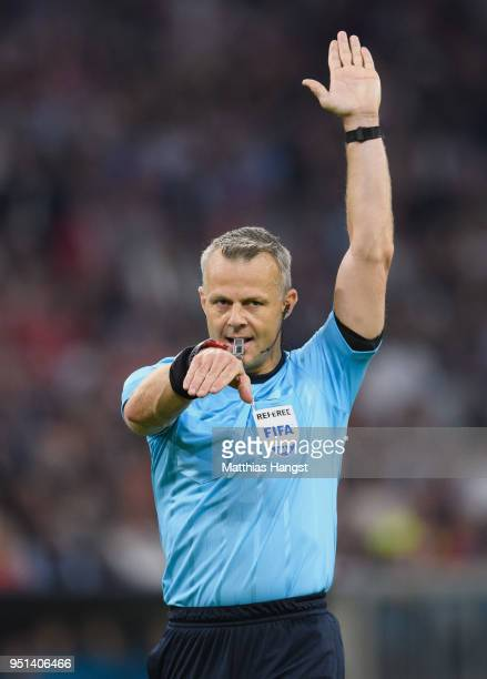 Referee Bjoern Kuipers gestures during the UEFA Champions League Semi Final First Leg match between Bayern Muenchen and Real Madrid at the Allianz...