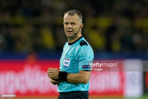 Referee Bjoern Kuipers looks on during the UEFA Champions League group H match between Borussia Dortmund and Real Madrid at Signal Iduna Park on...