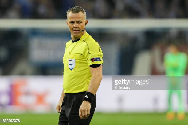 Referee Bjoern Kuipers looks on during the UEFA Europa League Round of 16 first leg match between FC Schalke 04 and Borussia Moenchengladbach at...