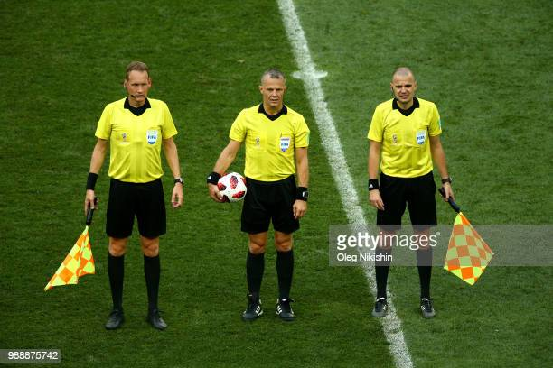 Referee Bjorn Kuipers and his linesmen Sander Van Roekel and Erwin Zeinstra wait at half time during the 2018 FIFA World Cup Russia Round of 16 match...