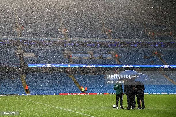 Referee Bjorn Kuipers assesses the waterlogged pitch prior to the UEFA Champions League Group A match between Manchester City FC and VfL Borussia...