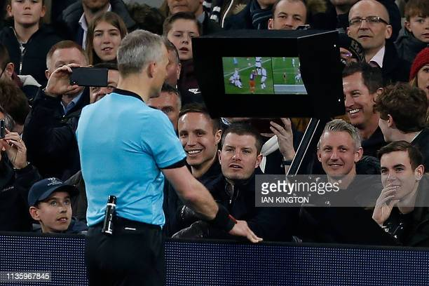Referee Bjorn Kuipers checks the VAR screen before awarding a penalty for a hand ball by Tottenham Hotspur's English defender Danny Rose during the...