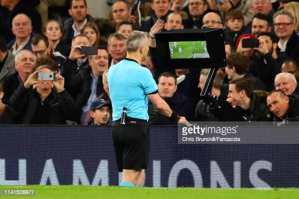 Referee Bjorn Kuipers checks the VAR screen during the UEFA Champions League Quarter Final first leg match between Tottenham Hotspur and Manchester...