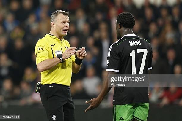 Referee Bjorn Kuipers Elvis Manu of Feyenoord during the Dutch Eredivisie match between PSV Eindhoven and Feyenoord at the Phillips stadium on...
