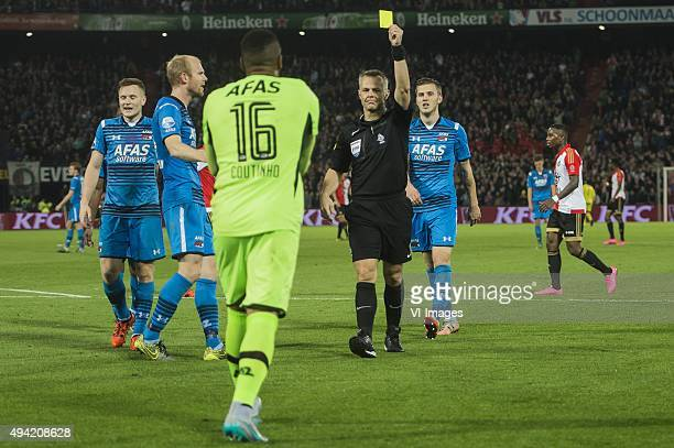 referee Bjorn Kuipers give a yellow card to Goalkeeper Gino Coutinho of AZ Alkmaar during the Dutch Eredivisie match between Feyenoord rotterdam and...