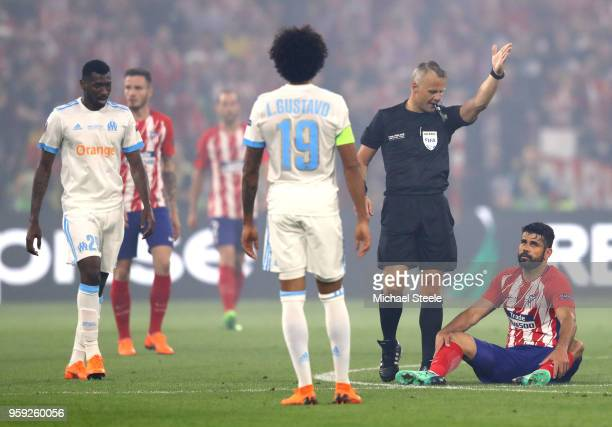 referee Bjorn Kuipers gives a freekick in favor of Diego Costa of Atletico Madrid during the UEFA Europa League Final between Olympique de Marseille...
