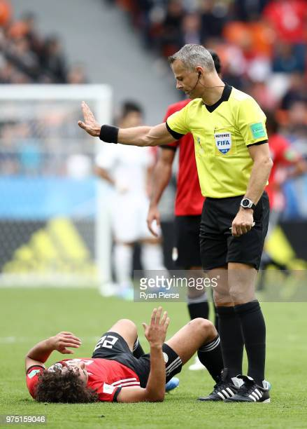 Referee Bjorn Kuipers gives instruction as Amr Warda of Egypt goes down injured during the 2018 FIFA World Cup Russia group A match between Egypt and...