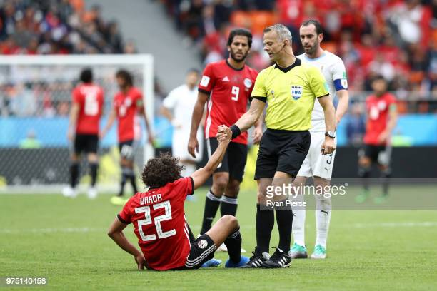 Referee Bjorn Kuipers helps Amr Warda of Egypt during the 2018 FIFA World Cup Russia group A match between Egypt and Uruguay at Ekaterinburg Arena on...
