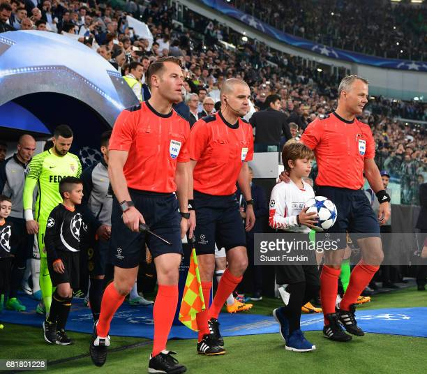 Referee Bjorn Kuipers leads his assiistants during the UEFA Champions League Semi Final second leg match between Juventus and AS Monaco at Juventus...
