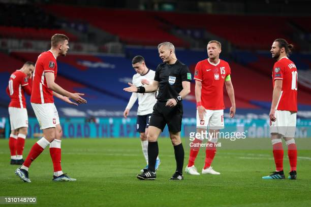 Referee Bjorn Kuipers points to the penalty spot after Raheem Sterling of England is fouled during the FIFA World Cup 2022 Qatar qualifying match...