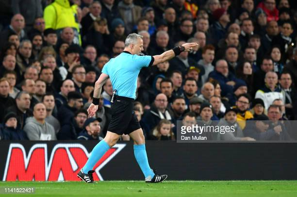 Referee Bjorn Kuipers points to the spot to award Manchester City a penalty after reviewing VAR during the UEFA Champions League Quarter Final first...