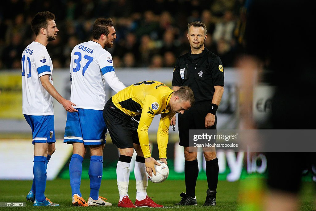 Referee, Bjorn Kuipers reacts after he points to the penalty spot for NAC during the Eredivisie match between NAC Breda and Vitesse at the Rat Verlegh Stadion on March 8, 2014 in Breda, Netherlands.