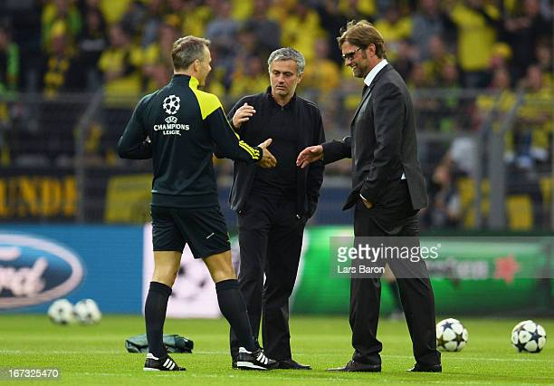 Referee Bjorn Kuipers shakes hands with head coach Jose Mourinho of Real Madrid and Head Coach Jurgen Klopp of Borussia Dortmund during the UEFA...