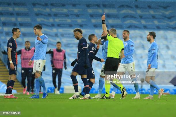 Referee Bjorn Kuipers shows Angel Di Maria of PSG a red card during the UEFA Champions League Semi Final Second Leg match between Manchester City and...
