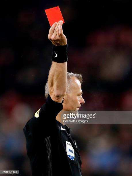 Referee Bjorn Kuipers shows red card during the Dutch Eredivisie match between PSV v ADO Den Haag at the Philips Stadium on December 16 2017 in...