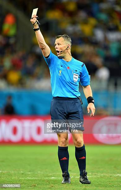 Referee Bjorn Kuipers shows the yellow card during the 2014 FIFA World Cup Brazil Group E match between Switzerland and France at Arena Fonte Nova on...
