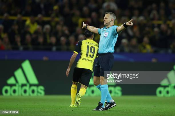 Referee Bjorn Kuipers signals during the UEFA Champions League group H match between Borussia Dortmund and Real Madrid at Signal Iduna Park on...