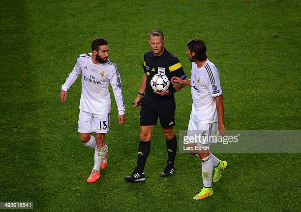 Referee Bjorn Kuipers speaks to Daniel Carvajal and Sami Khedira of Real Madrid as they go in at half time during the UEFA Champions League Final...