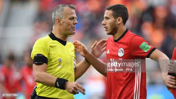 Referee Bjorn Kuipers speaks to Ramadan Sobhy of Egypt during the 2018 FIFA World Cup Russia group A match between Egypt and Uruguay at Ekaterinburg...