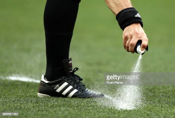 Referee Bjorn Kuipers uses vanishing spray to mark the placement of a free kick during the 2018 FIFA World Cup Russia Round of 16 match between Spain...