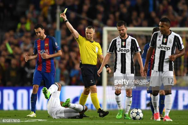 Referee Björn Kuipers shows Andres Iniesta of Barcelona a yellow card during the UEFA Champions League Quarter Final second leg match between FC...