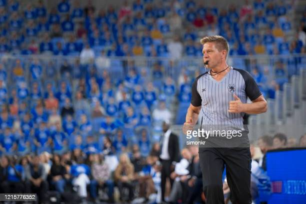 referee blowing whistle - referee stock pictures, royalty-free photos & images