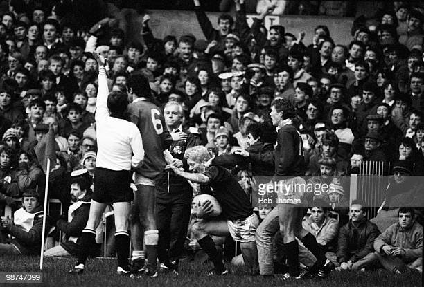 Referee Bob Francis of New Zealand signals a Try for Scotland against Wales as scorer John Jeffrey is congratulated during the Rugby Union...