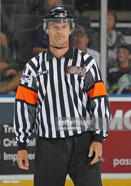 Referee Bob Langdon works his final OHL game between the London Knights and the Kingston Frontenacs at Budweiser Gardens on September 26 2015 in...