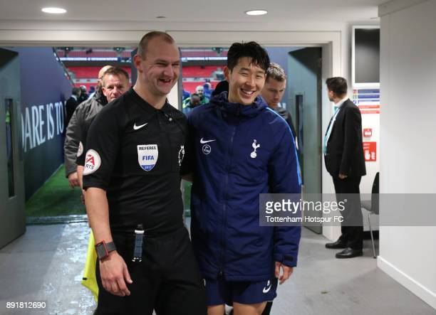 Referee Bobby Madley and HeungMin Son of Tottenham Hotspur have there photo taken in the tunnel after the Premier League match between Tottenham...