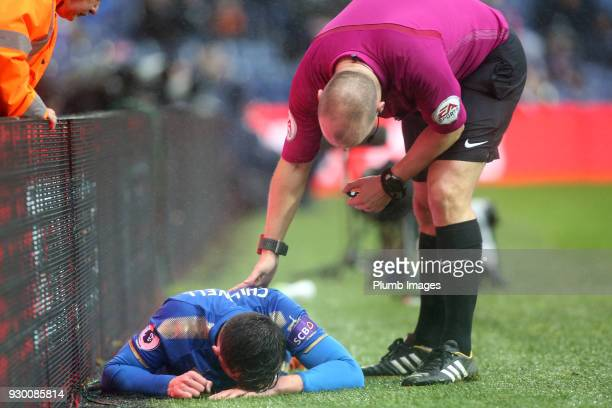 Referee Bobby Madley checks on Ben Chilwell of Leicester City after he collides with the advertising boards during the Premier League match between...
