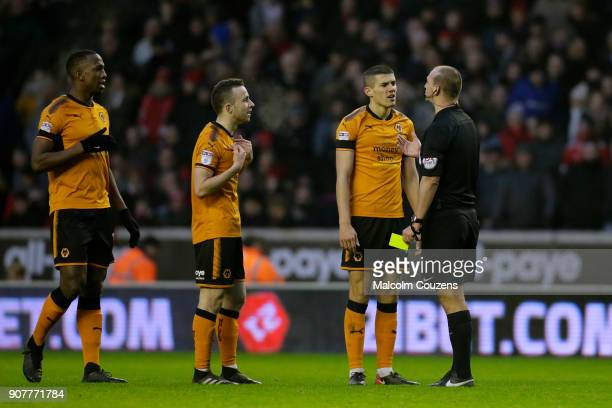 Referee Bobby Madley makes a point to Willy Boly Diogo Jota and Conor Coady of Wolverhampton Wanderers during the Sky Bet Championship match between...
