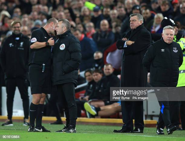 referee Bobby Madley speaks to the fourth official during the FA Cup third round match at Anfield Liverpool