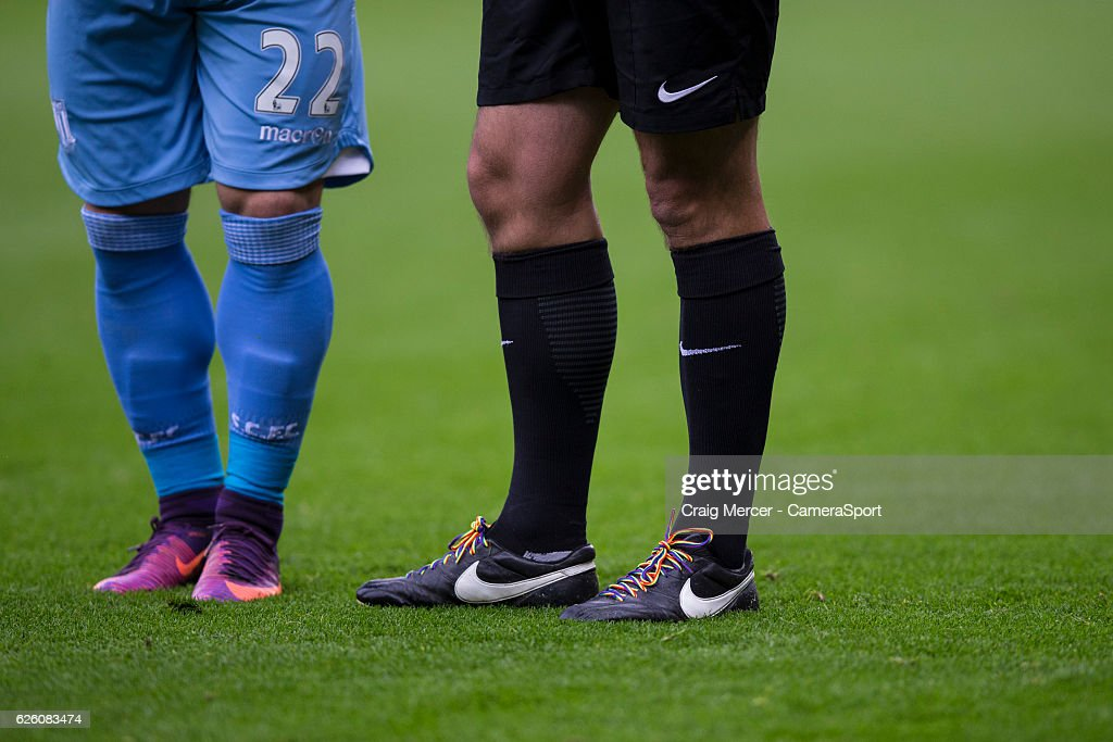 Referee Bobby Madley wearing rainbow coloured laces during the Premier League match between Watford and Stoke City at Vicarage Road on November 27, 2016 in Watford, England.