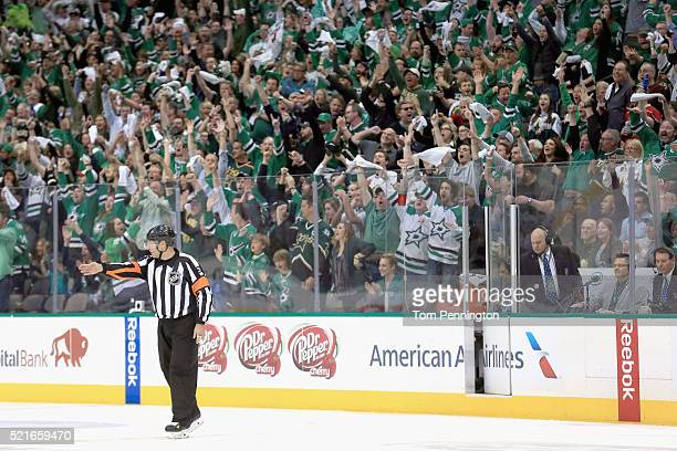 Referee Brad Meier signals for a Dallas Stars goal against the Minnesota Wild after a review in the second period in Game Two of the Western...