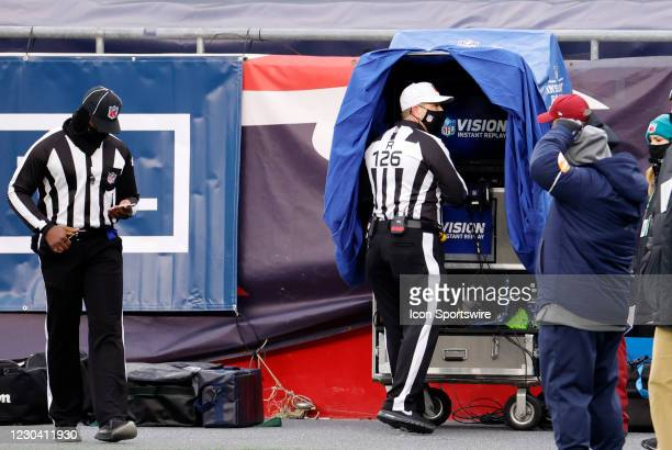 Referee Brad Rogers checks a replay during a game between the New England Patriots and the New York Jets on January 3 at Gillette Stadium in...