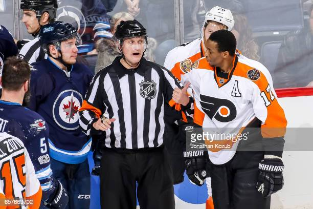 Referee Brad Watson separates Marko Dano of the Winnipeg Jets and Wayne Simmonds of the Philadelphia Flyers after a third period scrum at the MTS...