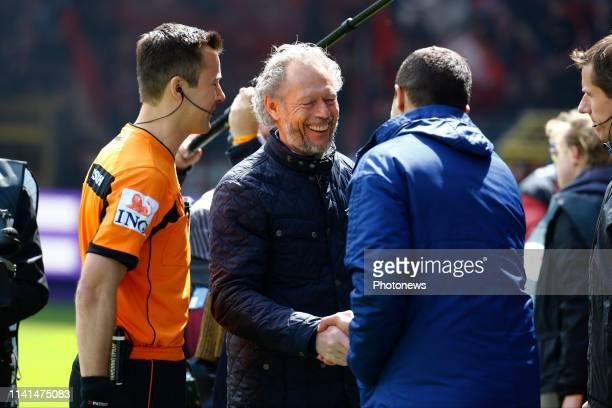 referee Bram Van Driessche and Michel Preud'homme head coach of Standard Liege and Fred Rutten head coach of Anderlecht pictured during the Jupiler...