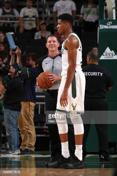 NBA referee Brent Barnaky smiles at Giannis Antetokounmpo of the Milwaukee Bucks during the game against the Chicago Bulls during a preseason game on...