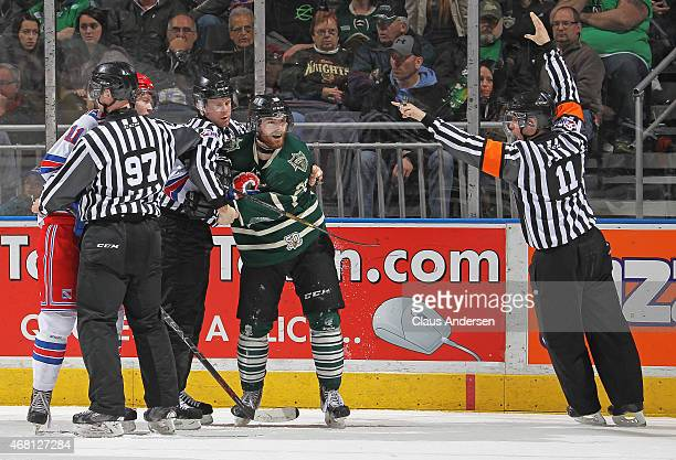 Referee Brent Montsion signals a penalty during play between the Kitchener Rangers and the London Knights during Game Two of the Western Conference...