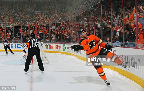 Referee Brian Pochmara signals a good goal by Nick Cousins of the Philadelphia Flyers during the shootout against the Washington Capitals on March 30...