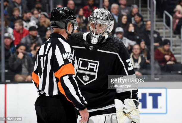 Referee Brian Pochmara talks with goaltender Jonathan Quick of the Los Angeles Kings during the second period of the game against the Arizona Coyotes...