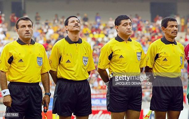 Referee Byron Moreno from Ecuador , fourth official Saad Mane, assistant referee Bomer Fierro from Ecuador and assistant referee Awni Hassouneh from...
