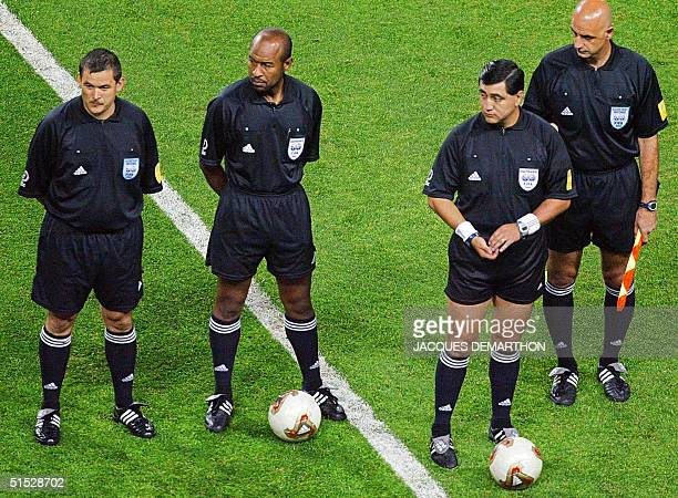 Referee Byron Moreno gets ready with fourth official Mohamed Guezzaz of Morocco , assistant referee Jorge Rattalino of Argentina and assistant...